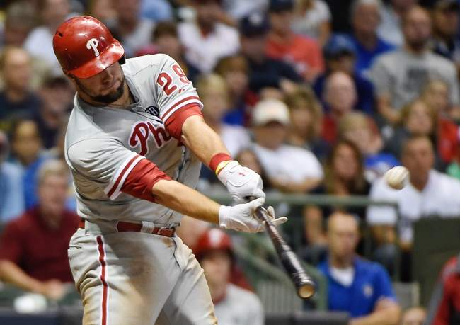 Jul 9, 2014; Milwaukee, WI, USA; Philadelphia Phillies catcher Cameron Rupp (29) hits a single to drive in a run in the seventh inning against the Milwaukee Brewers at Miller Park. The Phillies beat the Brewers 4-1. Mandatory Credit: Benny Sieu-USA TODAY Sports