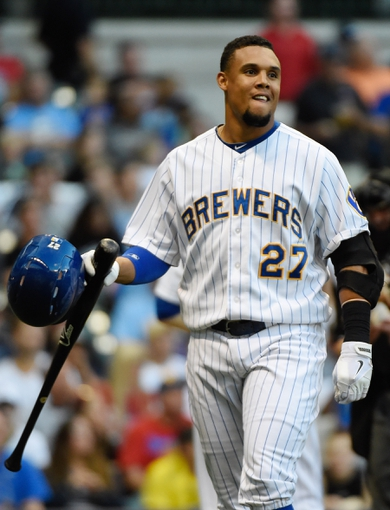 Jul 9, 2014; Milwaukee, WI, USA; Milwaukee Brewers center fielder Carlos Gomez (27) reacts after striking out in the third inning against the Philadelphia Phillies at Miller Park. The Phillies beat the Brewers 4-1. Mandatory Credit: Benny Sieu-USA TODAY Sports