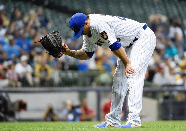 Jul 9, 2014; Milwaukee, WI, USA;  Milwaukee Brewers pitcher Kyle Lohse (26) reacts after making a throwing error allowing Philadelphia Phillies second baseman Chase Utley (not pictured) to reach 2nd base in the eighth inning at Miller Park. The Phillies beat the Brewers 4-1. Mandatory Credit: Benny Sieu-USA TODAY Sports