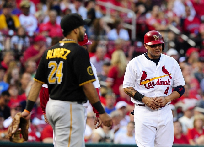 Jul 9, 2014; St. Louis, MO, USA; St. Louis Cardinals catcher Yadier Molina (4) holds his thumb after sliding into third during the second inning against the Pittsburgh Pirates at Busch Stadium. Mandatory Credit: Jeff Curry-USA TODAY Sports
