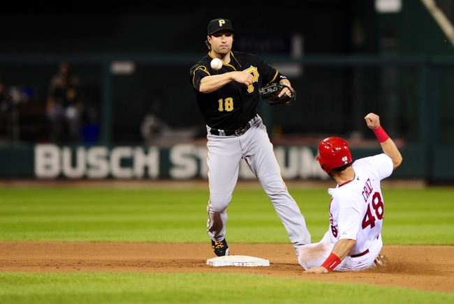 Jul 9, 2014; St. Louis, MO, USA; Pittsburgh Pirates second baseman Neil Walker (18) turns a double play as St. Louis Cardinals catcher Tony Cruz (48) slides during the fifth inning at Busch Stadium. Mandatory Credit: Jeff Curry-USA TODAY Sports