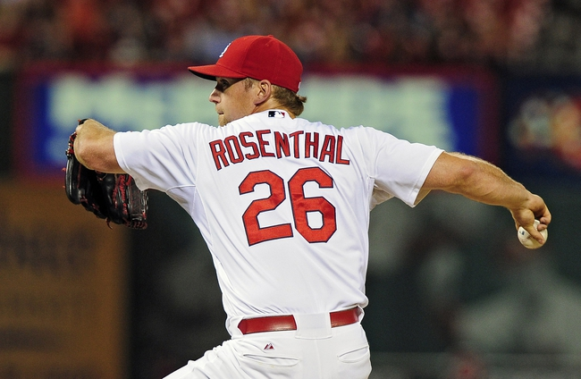 Jul 9, 2014; St. Louis, MO, USA; St. Louis Cardinals relief pitcher Trevor Rosenthal (26) throws to a Pittsburgh Pirates batter during the ninth inning at Busch Stadium. Cardinals defeated the Pirates 5-2. Mandatory Credit: Jeff Curry-USA TODAY Sports