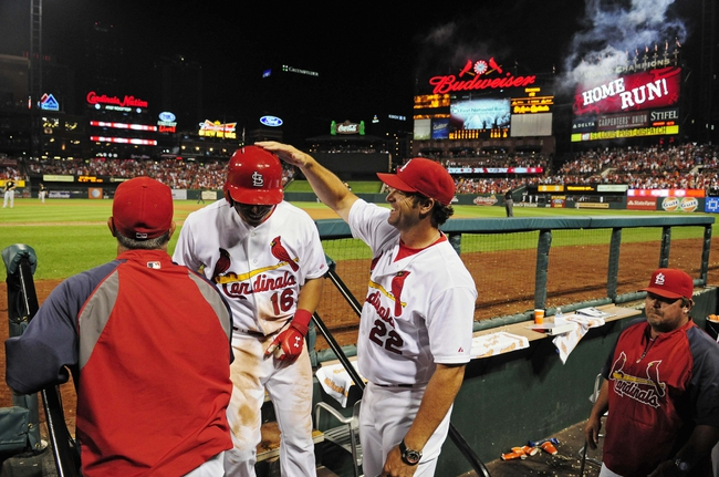 Jul 9, 2014; St. Louis, MO, USA; St. Louis Cardinals second baseman Kolten Wong (16) is congratulated by manager Mike Matheny (22) after hitting a solo home run during the seventh inning against the Pittsburgh Pirates at Busch Stadium. Cardinals defeated the Pirates 5-2. Mandatory Credit: Jeff Curry-USA TODAY Sports