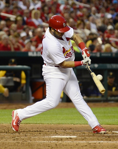 Jul 9, 2014; St. Louis, MO, USA; St. Louis Cardinals catcher Tony Cruz (48) breaks his bat as he ground out during the third inning against the Pittsburgh Pirates at Busch Stadium. Cardinals defeated the Pirates 5-2. Mandatory Credit: Jeff Curry-USA TODAY Sports