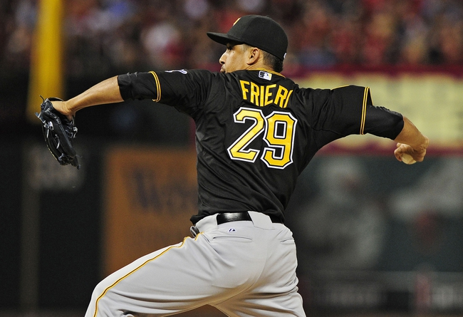 Jul 9, 2014; St. Louis, MO, USA; Pittsburgh Pirates relief pitcher Ernesto Frieri (29) throws to a St. Louis Cardinals batter during the fifth inning at Busch Stadium. Cardinals defeated the Pirates 5-2. Mandatory Credit: Jeff Curry-USA TODAY Sports