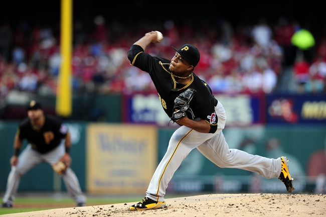 Jul 10, 2014; St. Louis, MO, USA; Pittsburgh Pirates starting pitcher Edinson Volquez (36) throws to a St. Louis Cardinals batter during the first inning at Busch Stadium. Mandatory Credit: Jeff Curry-USA TODAY Sports