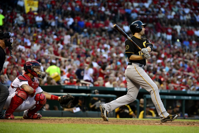 Jul 10, 2014; St. Louis, MO, USA; Pittsburgh Pirates second baseman Neil Walker (18) hits a two run double off of St. Louis Cardinals starting pitcher Shelby Miller (not pictured) during the fifth inning at Busch Stadium. Mandatory Credit: Jeff Curry-USA TODAY Sports