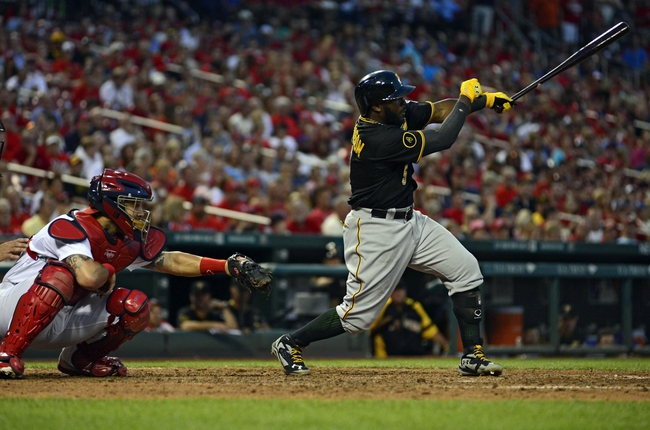 Jul 10, 2014; St. Louis, MO, USA; Pittsburgh Pirates right fielder Josh Harrison (5) hits a two run double off of St. Louis Cardinals relief pitcher Tyler Lyons (not pictured) during the sixth inning at Busch Stadium. Pirates defeated the Cardinals 9-1. Mandatory Credit: Jeff Curry-USA TODAY Sports