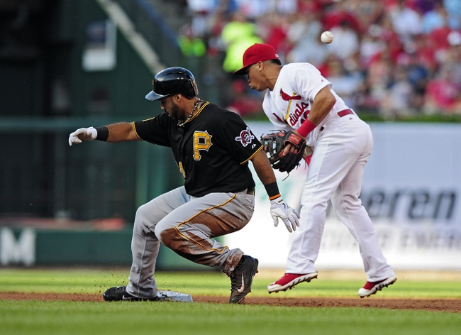 Jul 10, 2014; St. Louis, MO, USA; Pittsburgh Pirates third baseman Pedro Alvarez (24) slides safely into second for a double as St. Louis Cardinals second baseman Kolten Wong (16) bobbles the ball during the second inning at Busch Stadium. Pirates defeated the Cardinals 9-1. Mandatory Credit: Jeff Curry-USA TODAY Sports