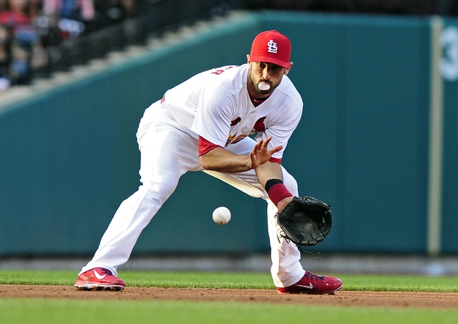 Jul 10, 2014; St. Louis, MO, USA; St. Louis Cardinals third baseman Matt Carpenter (13) fields ground ball hit by Pittsburgh Pirates catcher Russell Martin (not pictured) during the fourth inning at Busch Stadium. Pirates defeated the Cardinals 9-1. Mandatory Credit: Jeff Curry-USA TODAY Sports