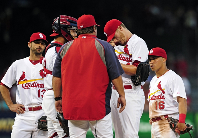 Jul 10, 2014; St. Louis, MO, USA; St. Louis Cardinals starting pitcher Shelby Miller (40) talks with pitching coach Derek Lilliquist (34) during the fifth inning against the Pittsburgh Pirates at Busch Stadium. Pirates defeated the Cardinals 9-1. Mandatory Credit: Jeff Curry-USA TODAY Sports