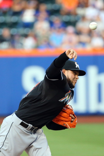 Jul 11, 2014; New York, NY, USA; Miami Marlins starting pitcher Henderson Alvarez (37) pitches during the first inning against the New York Mets at Citi Field. Mandatory Credit: Anthony Gruppuso-USA TODAY Sports