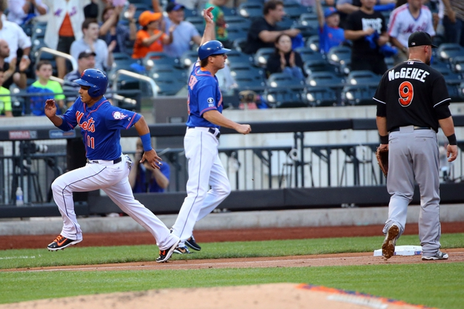 Jul 11, 2014; New York, NY, USA;  New York Mets shortstop Ruben Tejada (11) heads home on a double by starting pitcher Zack Wheeler (not pictured) during the second inning against the Miami Marlins at Citi Field. Mandatory Credit: Anthony Gruppuso-USA TODAY Sports