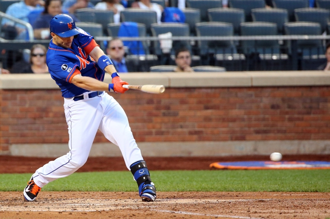Jul 11, 2014; New York, NY, USA;  New York Mets third baseman David Wright (5) singles to left during the third inning against the Miami Marlins at Citi Field. Mandatory Credit: Anthony Gruppuso-USA TODAY Sports