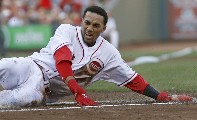 Jul 11, 2014; Cincinnati, OH, USA; Cincinnati Reds center fielder Billy Hamilton (6) scores at home after a by shortstop Zack Cozart (not pictured) in the first inning against the Pittsburgh Pirates at Great American Ball Park. Mandatory Credit: David Kohl-USA TODAY Sports