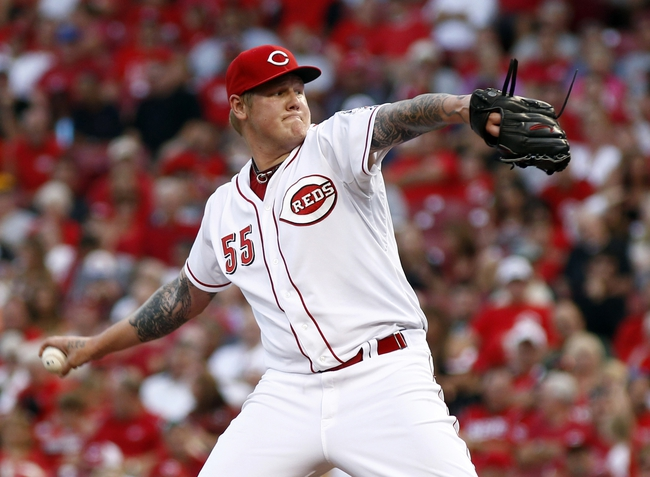 Jul 11, 2014; Cincinnati, OH, USA; Cincinnati Reds starting pitcher Mat Latos throws against the Pittsburgh Pirates in the fourth inning at Great American Ball Park. Mandatory Credit: David Kohl-USA TODAY Sports