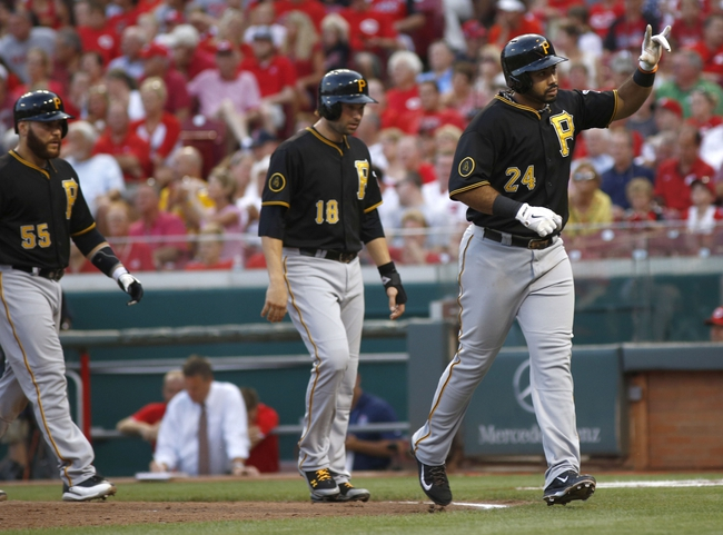 Jul 11, 2014; Cincinnati, OH, USA; Pittsburgh Pirates third baseman Pedro Alvarez (24) reacts after hitting a three-run home run off Cincinnati Reds starting pitcher Mat Latos (not pictured) in the fourth inning at Great American Ball Park. Pirates catcher Russell Martin (55) and second baseman Neil Walker (18) follow at left. Mandatory Credit: David Kohl-USA TODAY Sports