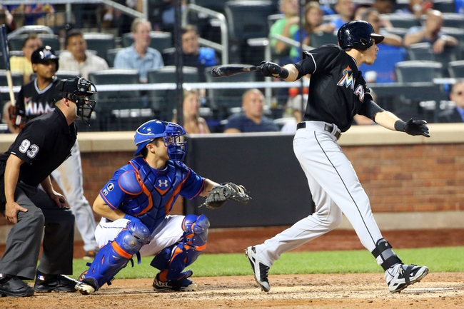 Jul 11, 2014; New York, NY, USA;  Miami Marlins left fielder Christian Yelich (21) singles to left center allowing a runner to score during the fifth inning against the New York Mets at Citi Field. Mandatory Credit: Anthony Gruppuso-USA TODAY Sports
