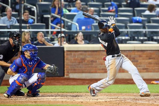 Jul 11, 2014; New York, NY, USA;  Miami Marlins shortstop Adeiny Hechavarria (3) singles to right during the fifth inning against the New York Mets at Citi Field. Mandatory Credit: Anthony Gruppuso-USA TODAY Sports