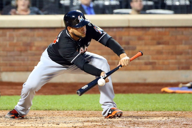 Jul 11, 2014; New York, NY, USA;  Miami Marlins starting pitcher Henderson Alvarez (37) bunts foul during the fifth inning against the New York Mets at Citi Field. Mandatory Credit: Anthony Gruppuso-USA TODAY Sports