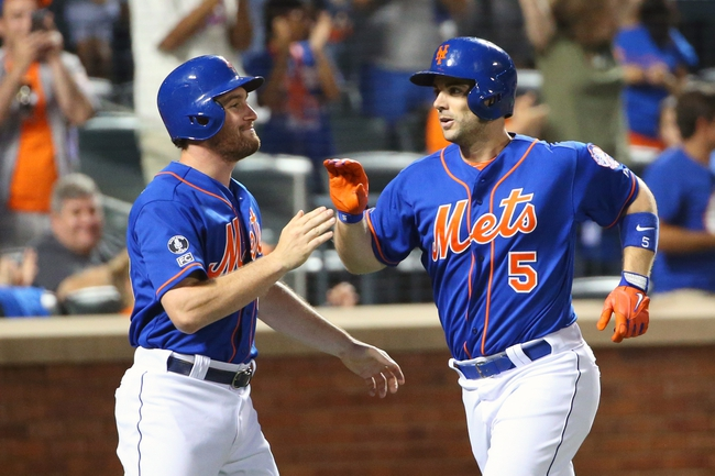 Jul 11, 2014; New York, NY, USA; New York Mets second baseman Daniel Murphy (28) and third baseman David Wright (5) celebrate scoring during the fifth inning against the Miami Marlins at Citi Field. Mandatory Credit: Anthony Gruppuso-USA TODAY Sports