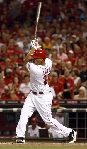Jul 11, 2014; Cincinnati, OH, USA; Cincinnati Reds pinch hitter Donald Lutz hits a single off Pittsburgh Pirates starting pitcher Jeff Locke (not pictured) in the seventh inning at Great American Ball Park. The Reds won 6-5. Mandatory Credit: David Kohl-USA TODAY Sports