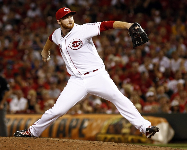 Jul 11, 2014; Cincinnati, OH, USA; Cincinnati Reds relief pitcher Curtis Partch throws against the Pittsburgh Pirates in the eighth inning at Great American Ball Park. The Reds won 6-5. Mandatory Credit: David Kohl-USA TODAY Sports