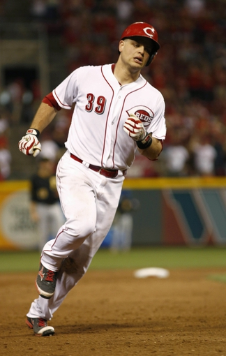 Jul 11, 2014; Cincinnati, OH, USA; Cincinnati Reds catcher Devin Mesoraco rounds the bases after hitting a solo home run in the eighth inning against the Pittsburgh Pirates at Great American Ball Park. The Reds won 6-5. Mandatory Credit: David Kohl-USA TODAY Sports