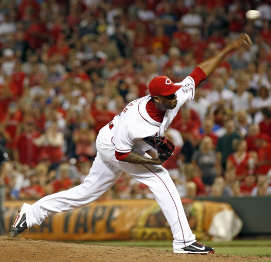Jul 11, 2014; Cincinnati, OH, USA; Cincinnati Reds relief pitcher Aroldis Chapman throws against the Pittsburgh Pirates in the ninth inning at Great American Ball Park. The Reds won 6-5. Mandatory Credit: David Kohl-USA TODAY Sports
