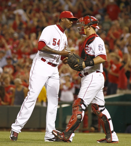 Jul 11, 2014; Cincinnati, OH, USA; Cincinnati Reds relief pitcher Aroldis Chapman (54) is congratulated by catcher Devin Mesoraco after the Reds defeated the Pittsburgh Pirates 6-5 at Great American Ball Park. Mandatory Credit: David Kohl-USA TODAY Sports