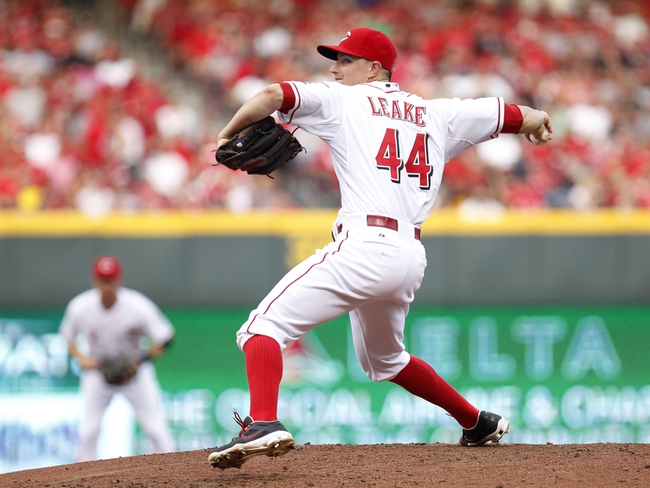 Jul 12, 2014; Cincinnati, OH, USA; Cincinnati Reds starting pitcher Mike Leake (44) pitches during the second inning against the Pittsburgh Pirates at Great American Ball Park. Mandatory Credit: Frank Victores-USA TODAY Sports