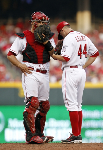 Jul 12, 2014; Cincinnati, OH, USA; Cincinnati Reds catcher Devin Mesoraco (39) talks to starting pitcher Mike Leake (44) during the second inning against the Pittsburgh Pirates at Great American Ball Park. Mandatory Credit: Frank Victores-USA TODAY Sports