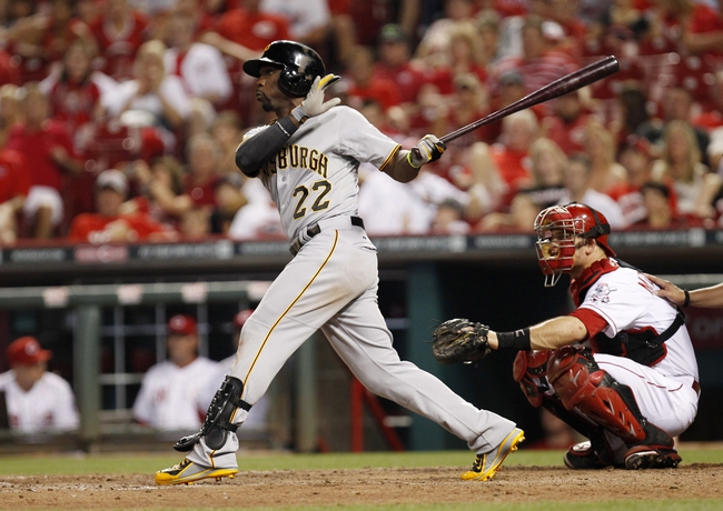 Jul 12, 2014; Cincinnati, OH, USA; Pittsburgh Pirates center fielder Andrew McCutchen (22) hits the game winning home run during the eleventh inning against the Cincinnati Reds at Great American Ball Park. The Pirates defeated the Reds 6-5. Mandatory Credit: Frank Victores-USA TODAY Sports