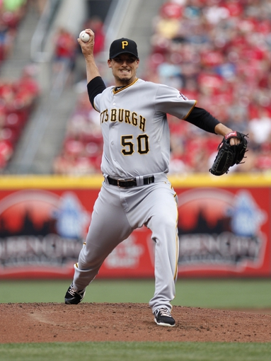 Jul 12, 2014; Cincinnati, OH, USA; Pittsburgh Pirates starting pitcher Charlie Morton (50) pitches during the first inning against the Cincinnati Reds at Great American Ball Park. Mandatory Credit: Frank Victores-USA TODAY Sports