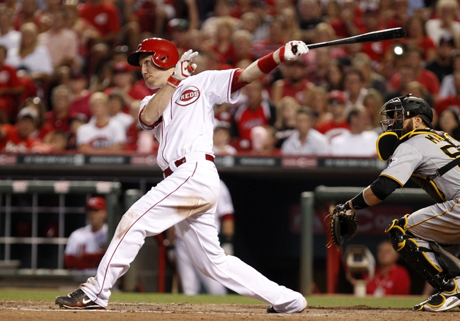 Jul 12, 2014; Cincinnati, OH, USA; Cincinnati Reds third baseman Todd Frazier (21) hits a home run during the sixth inning against the Pittsburgh Pirates at Great American Ball Park. The Pirates defeated the Reds 6-5. Mandatory Credit: Frank Victores-USA TODAY Sports