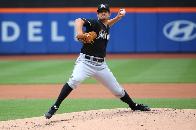 Jul 13, 2014; New York, NY, USA;  Miami Marlins starting pitcher Brad Hand (52) pitches during the first inning against the New York Mets at Citi Field. Mandatory Credit: Anthony Gruppuso-USA TODAY Sports