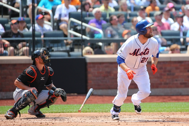 Jul 13, 2014; New York, NY, USA; New York Mets first baseman Lucas Duda (21) flies out during the third inning against the Miami Marlins at Citi Field. Mandatory Credit: Anthony Gruppuso-USA TODAY Sports