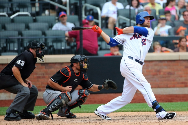 Jul 13, 2014; New York, NY, USA;  New York Mets first baseman Lucas Duda (21) singles to center allowing right fielder Curtis Granderson (3) (not pictured) to score during the eighth inning against the Miami Marlins at Citi Field. New York Mets won 9-1.  Mandatory Credit: Anthony Gruppuso-USA TODAY Sports