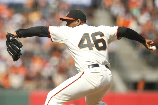 Jul 13, 2014; San Francisco, CA, USA; San Francisco Giants pitcher Santiago Casilla (46) prepares to deliver a pitch against the Arizona Diamondbacks in the ninth inning at AT&T Park. The Giants defeated the Diamondbacks 8-4. Mandatory Credit: Cary Edmondson-USA TODAY Sports