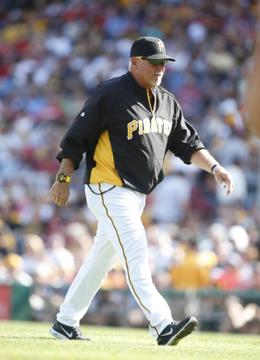 Jul 5, 2014; Pittsburgh, PA, USA; Pittsburgh Pirates pitching coach Ray Searage (54) returns to the dugout after a visit to the the mound against the Philadelphia Phillies during the third inning at PNC Park. The Pirates won 3-2. Mandatory Credit: Charles LeClaire-USA TODAY Sports