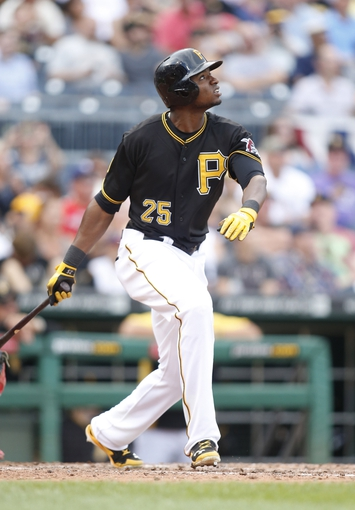 Jul 5, 2014; Pittsburgh, PA, USA; Pittsburgh Pirates right fielder Gregory Polanco (25) at bat against the Philadelphia Phillies during the seventh inning at PNC Park. The Pirates won 3-2. Mandatory Credit: Charles LeClaire-USA TODAY Sports