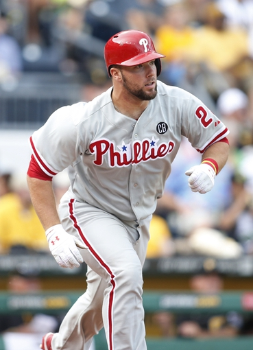 Jul 5, 2014; Pittsburgh, PA, USA; Philadelphia Phillies catcher Cameron Rupp (29) runs to first base against the Pittsburgh Pirates during the seventh inning at PNC Park. The Pirates won 3-2. Mandatory Credit: Charles LeClaire-USA TODAY Sports