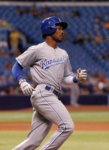 Jul 7, 2014; St. Petersburg, FL, USA; Kansas City Royals center fielder Jarrod Dyson (1) singles against the Tampa Bay Rays at Tropicana Field. Mandatory Credit: Kim Klement-USA TODAY Sports
