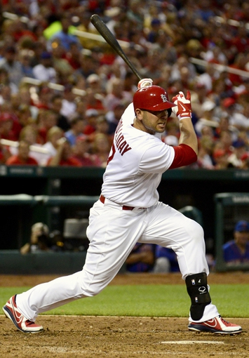 Jun 17, 2014; St. Louis, MO, USA; St. Louis Cardinals left fielder Matt Holliday (7) hits a one run double off of a New York Mets starting pitcher during the fifth inning at Busch Stadium. Mandatory Credit: Jeff Curry-USA TODAY Sports