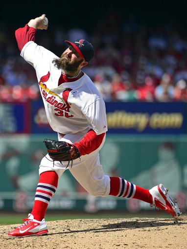 Jun 15, 2014; St. Louis, MO, USA; St. Louis Cardinals relief pitcher Jason Motte (30) delivers a pitch against the Washington Nationals during the eighth inning at Busch Stadium. Mandatory Credit: Scott Rovak-USA TODAY Sports