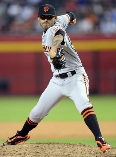 Jun 21, 2014; Phoenix, AZ, USA; San Francisco Giants relief pitcher Sergio Romo (54) pitches in the ninth inning against the Arizona Diamondbacks at Chase Field. The Giants won 6-4. Mandatory Credit: Joe Camporeale-USA TODAY Sports