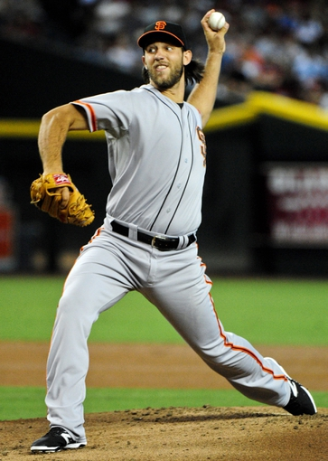 Jun 22, 2014; Phoenix, AZ, USA; San Francisco Giants starting pitcher Madison Bumgarner (40) throws during the first inning against the Arizona Diamondbacks at Chase Field. Mandatory Credit: Matt Kartozian-USA TODAY Sports
