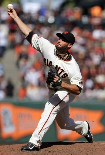 Sep 29, 2013; San Francisco, CA, USA; San Francisco Giants relief pitcher George Kontos (70) pitches the ball against the San Diego Padres during the seventh inning at AT&T Park. Mandatory Credit: Kelley L Cox-USA TODAY Sports