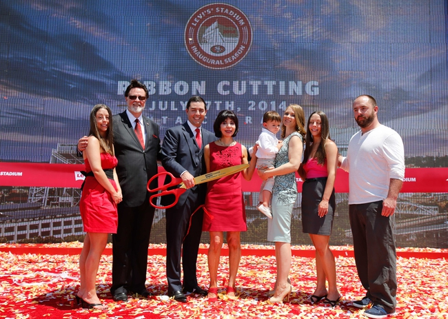 Jul 17, 2014; Santa Clara, CA, USA; San Francisco 49ers CEO Jed York holds the scissors from the ribbon cutting ceremony at Levi's Stadium between his father John York and mother Marie DeBartolo with his sisters, brother, wife and son. Mandatory Credit: Kelley L Cox-USA TODAY Sports