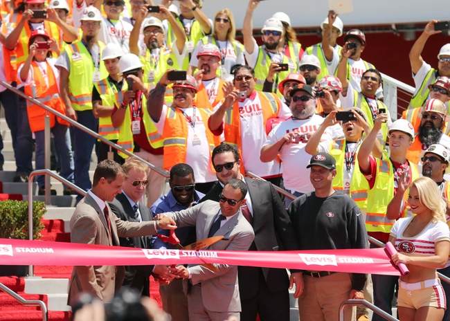 Jul 17, 2014; San Francisco, CA, USA; San Francisco 49ers general manager Trent Baalke , NFL commissioner Roger Goodell and 49ers president Paraag Marathe cut the ribbon with 49ers linebacker Patrick Willis , offensive tackle Joe Staley and head coach Jim Harbaugh as construction workers cheer and take photos at the ribbon cutting ceremony at Levi's Stadium. Mandatory Credit: Kelley L Cox-USA TODAY Sports